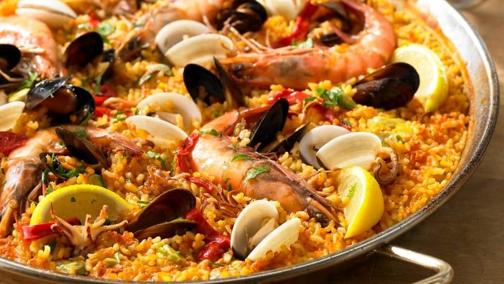 Una paella solidale per aiutare gli orfani della sierra for Restaurante puerto rico madrid